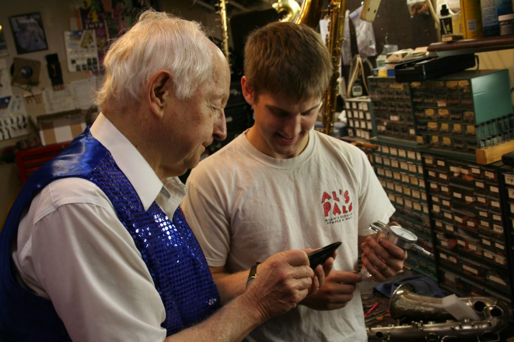 Bob after a local gig, inspecting mouthpieces with Chadd.